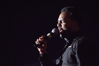 A member of Syracuse University's Martin Luther King Community Choir performs.